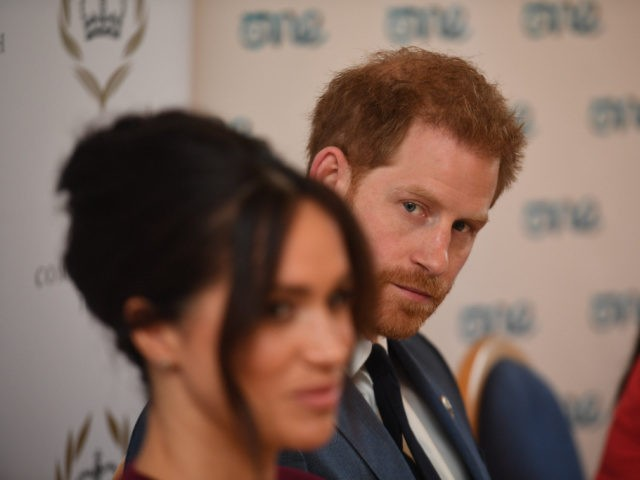 Britain's Prince Harry, Duke of Sussex (R) and Meghan, Duchess of Sussex attend a roundtable discussion on gender equality with The Queens Commonwealth Trust (QCT) and One Young World at Windsor Castle in Windsor on October 25, 2019. (Photo by Jeremy Selwyn / POOL / AFP) (Photo by JEREMY SELWYN/POOL/AFP …