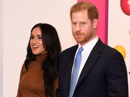 Britain's Prince Harry, Duke of Sussex and Meghan, Duchess of Sussex react as they view a special exhibition of art by Indigenous Canadian artist, Skawennati, in the Canada Gallery during their visit to Canada House, in London on January 7, 2020, to give thanks for the warm Canadian hospitality and …
