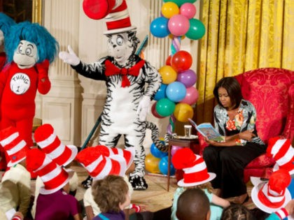 "First lady Michelle Obama, with Dr. Seuss characters the Cat in the Hat, Thing 1 and Thing 2, reads to local students as part of her ""Let's Move, Let's Read!"" initiative, Wednesday, Jan. 21, 2015. (AP Photo/Jacquelyn Martin)"