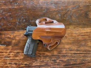 Sig Sauer P2022 in a DeSantis Speed Scabbard holster (AWR Hawkins)
