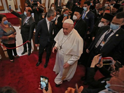 Pope Francis greets worshippers upon his arrival at the Syriac Catholic Cathedral of Our Lady of Salvation (Sayidat al-Najat) in the capital Baghdad at the start of the first ever papal visit to Iraq on March 5, 2021. - In an address to the faithful in Baghdad, Pope Francis expressed …