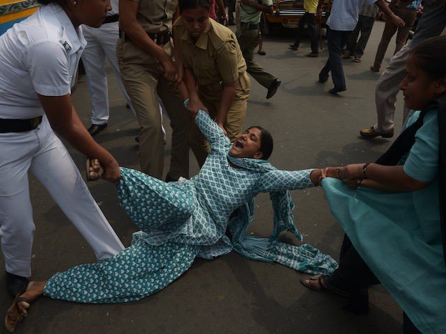 Indian police arrest activists from the Social Unity Centre of India (SUCI) organisation as they block a road during a protest against a gang rape in Kolkata on May 31, 2016. (Dibyangshu Sarkar/AFP via Getty Images)