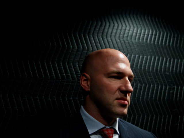Rep.-elect Anthony Gonzalez, R-Ohio leans against the back on an elevator as he leaves an interview with the Associated Press at the National Republican Congressional Committee offices in Washington, Thursday Nov. 29, 2018. (AP Photo/Carolyn Kaster)