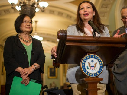 WASHINGTON, DC - AUGUST 21: Sen. Tammy Duckworth (D-IL) speaks during a weekly news conference on Capitol Hill on August 21, 2018 in Washington, DC. Also pictured are Sen. Mazie Hirono (D-HI) and Senate Minority Leader Chuck Schumer (D-NY). (Photo by Zach Gibson/Getty Images)