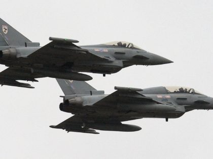 Two British Royal Air Force Typhoon FGR4 aircraft fly over RAF Waddington near Lincoln, England on February 29, 2012, before British Defence Secretary Philip Hammond arrives to observe a London 2012 Olympic Games air security training exercise, codenamed Exercise Taurus Mountain 2. Aircraft including RAF Typhoon interceptors, RAF E-3D Sentry …