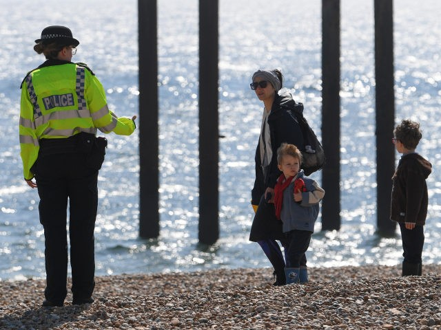 BRIGHTON, UNITED KINGDOM - APRIL 25: A police officer encourages people to leave the beach on April 25, 2020 in Brighton, United Kingdom. The British government has extended the lockdown restrictions first introduced on March 23 that are meant to slow the spread of COVID-19. (Photo by Mike Hewitt/Getty Images)