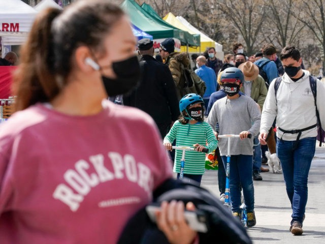 Shoppers at the Union Square farmers market wear masks to protect against the coronavirus, Friday, March 26, 2021, in New York. A year after becoming a global epicenter of the coronavirus pandemic, New York and New Jersey are back atop the list of U.S. states with the highest rates of …