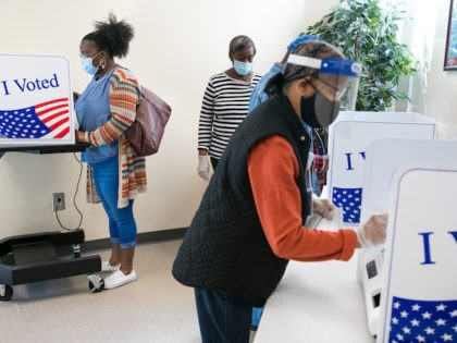 People cast votes at the Richland County Voter Registration & Elections Office on the second day of in-person absentee and early voting on October 6, 2020 in Columbia, South Carolina. (Sean Rayford/Getty Images)