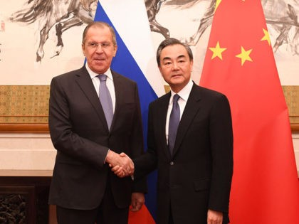 BEIJING, CHINA - APRIL 22: Russia's Foreign Minister Sergei Lavrov (left) shakes hands with Chinese State Councilor and Foreign Minister Wang Yi (right) at the Diaoyutai State Guest House in Beijing, China, April 23, 2018. (Photo by Madoka Ikegami-Pool/Getty Images)