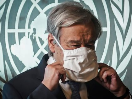 United Nations Secretary-General António Guterres adjusts his face mask following an interview, Wednesday Oct. 21, 2020, at U.N. headquarters. (AP Photo/Bebeto Matthews)