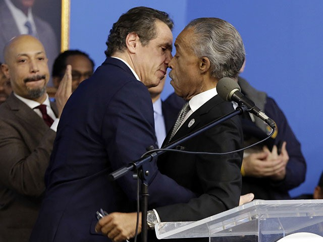 In this file photo, New York Gov. Andrew Cuomo, left, Rev. Al Sharpton embrace as Cuomo is introduced at the National Action Network House of Justice, in New York, Monday, Jan. 15, 2018. (Richard Drew/AP Photo)