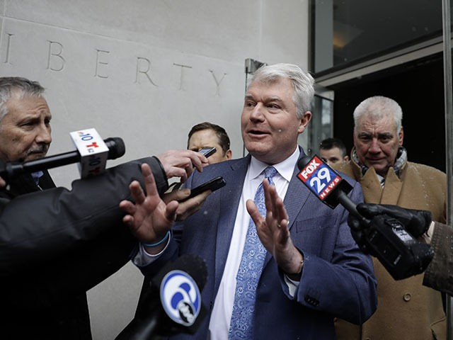 """In this Feb. 1, 2019 file photo John """"Johnny Doc"""" Dougherty, Local 98 leader, speaks to the media as he departs the federal courthouse, in Philadelphia. (AP Photo/Matt Slocum, File)"""