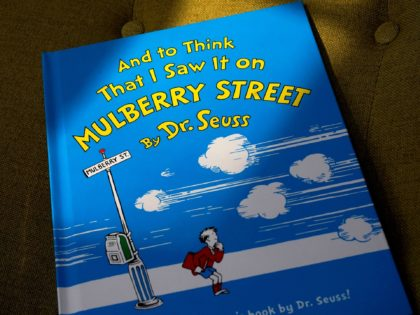 "A copy of the book ""And to Think That I Saw It on Mulberry Street,"" by Dr. Seuss, rests in a chair, Monday, March 1, 2021, in Walpole, Mass. Dr. Seuss Enterprises, the business that preserves and protects the author and illustrator's legacy, announced on his birthday, Tuesday, March 2, …"