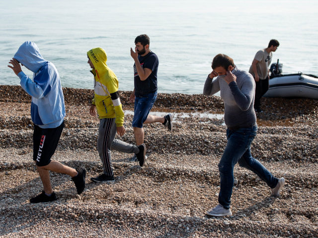 DEAL, ENGLAND - SEPTEMBER 14: Migrants make their way inland after landing on Deal beach after crossing the English channel from France in a dinghy on September 14, 2020 in Deal, England. More than 1,468 migrants, some of them children, crossed the English Channel by small boat in August, despite …
