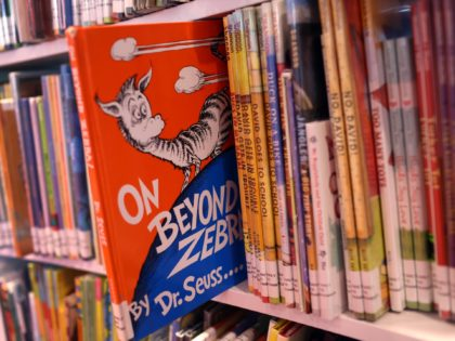 "CHICAGO, ILLINOIS - MARCH 02: Books by Theodor Seuss Geisel, aka Dr. Seuss, including ""On Beyond Zebra!"" and ""And to Think That I Saw it on Mulberry Street,"" are offered for loan at the Chinatown Branch of the Chicago Public Library on March 02, 2021 in Chicago, Illinois. The two …"