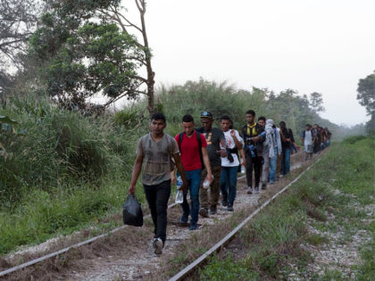 Migrants walk on train tracks on their journey from Central America to the U.S. border., in Palenque, Chiapas state, Mexico, Wednesday, Feb. 10, 2021. President Joe Biden's administration has taken steps toward rolling back some of the harshest policies of ex-President Donald Trump, but a policy remains allowing U.S. border …