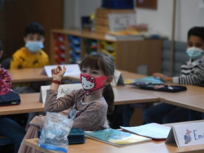 Second-grade pupils wear face masks as they attend school lessons at the Petri primary school in Dortmund, western Germany, on February 22, 2021, amid the novel coronavirus COVID-19 pandemic. - Schools and daycare centres partially reopened in 10 German regions. The impact of school reopenings would be closely watched before …