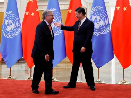 United Nations Secretary General Antonio Guterres (L) is welcomed by China's President Xi Jinping (R) before their bilateral meeting at the Great Hall of the People in Beijing on September 2, 2018. (Photo by Andy Wong / POOL / AFP) (Photo credit should read ANDY WONG/AFP via Getty Images)