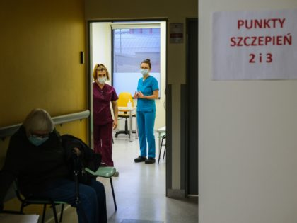 KRAKOW, POLAND - JANUARY 25: Health workers wear protective face masks and gloves as they wait for elderly to give a Pfizer/BioNTech COVID-19 jab at the Krakow University Hospital on January 25, 2021 in Krakow, Poland. Today, Poland begins the next stage of its COVID-19 vaccine rollout for elderly aged …