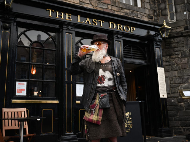 EDINBURGH, SCOTLAND - OCTOBER 07: Charles Douglas Barr enjoys a pint outside The Last Drop pub in the Grassmarket on October 7, 2020 in Edinburgh, Scotland. Scottish First Minister Nicola Sturgeon announced that pubs and restaurants across the country's central belt, including Edinburgh and Glasgow, will close from Friday at …