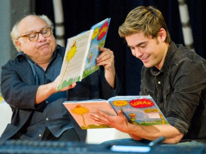 "Dr. Seuss' ""The Lorax"" stars Danny DeVito, left, and Zac Efron read to school children at the National Education Association's 15th annual Read Across America Day at The New York Public Libary, in New York, Friday, March 2, 2012. (AP Photo/Charles Sykes)"