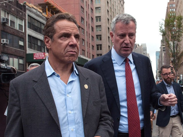 In this file photo, New York City Mayor Bill de Blasio (R) and New York Gov. Andrew Cuomo tour the site of the bomb blast on 23rd St. in Manhattan's Chelsea neighborhood on September 18, 2016 in New York City. An explosion that injured 29 people which went off in …