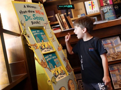 "CORAL GABLES, FL - JULY 28: Sebastian Alonso, 6, looks at a display of Dr. Seuss' never-before-published book, ""What Pet Should I Get?"" on the day it is released for sale at the Books and Books store on July 28, 2015 in Coral Gables, United States. The manuscript by the …"