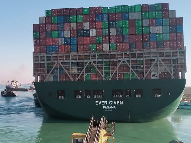 This picture taken on March 29, 2021 from a nearby tugboat in the Suez Canal shows a view of the Panama-flagged MV 'Ever Given' (operated by Taiwan-based Evergreen Marine) container ship as it begins to move. - Egypt's Suez Canal Authority said on March 29 the Ever Given container ship, …