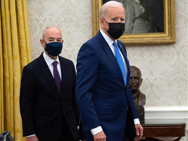 US President Joe Biden stands alongside Secretary of Homeland Security Alejandro Mayorkas (L) after signing executive orders related to immigration in the Oval Office of the White House in Washington, DC, February 2, 2021. (Photo by SAUL LOEB / AFP) (Photo by SAUL LOEB/AFP via Getty Images)