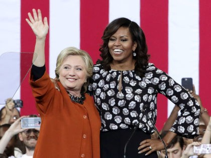 WINSTON-SALEM, NC - OCTOBER 27: Democratic presidential candidate Hillary Clinton (L) and U.S. first lady Michelle Obama (R) greet supporters during a campaign event at the Lawrence Joel Veterans Memorial Coliseum October 27, 2016 in Winston-Salem, North Carolina. The first lady joined Clinton for the first time to campaign for …