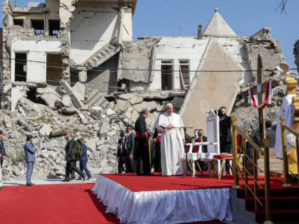 Pope Francis, surrounded by shells of destroyed churches, arrives to pray for the victims of war at Hosh al-Bieaa Church Square, in Mosul, Iraq, once the de-facto capital of IS, Sunday, March 7, 2021. The long 2014-2017 war to drive IS out left ransacked homes and charred or pulverized buildings …