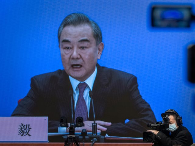 BEIJING, CHINA - MARCH 07: China's Foreign Minister Wang Yi, on screen, answers a question during a video news conference, held remotely as a precaution for COVID-19, as part of the National People's Congress on March 7, 2021 in Beijing, China.The annual political gatherings of the National Peoples Congress and …