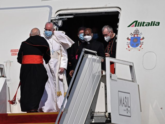 Pope Francis arrives in Baghdad on March 5, 2021 in his first visit to Iraq. - Pope Francis began his historic trip to war-scarred Iraq, defying security concerns and the coronavirus pandemic to comfort one of the world's oldest and most persecuted Christian communities. (Photo by Vincenzo PINTO / AFP) …
