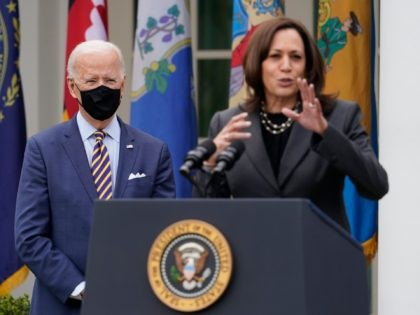 President Joe Biden listens as Vice President Kamala Harris speaks about the American Rescue Plan, a coronavirus relief package, in the Rose Garden of the White House, Friday, March 12, 2021, in Washington. (AP Photo/Alex Brandon)