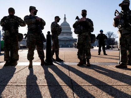 Members of the Michigan National Guard and the U.S. Capitol Police keep watch as heightened security remains in effect around the Capitol grounds since the Jan. 6 attacks by a mob of supporters of then-President Donald Trump, in Washington, Wednesday, March 3, 2021. The U.S. Capitol Police say they have …