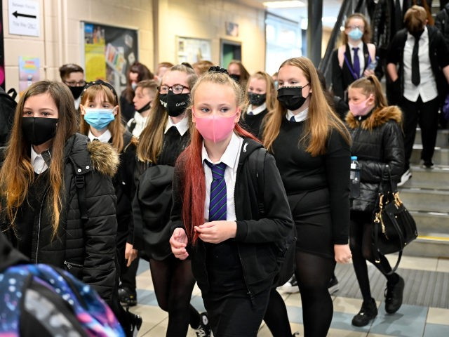 GLASGOW, SCOTLAND - AUGUST 31: Pupils at Rosshall Academy wear face coverings as it becomes mandatory in corridors and communal areas on August 31, 2020 in Glasgow, Scotland. New rules starting today require children over 12 to wear face coverings in corridors and other communal areas in schools in Scotland. …