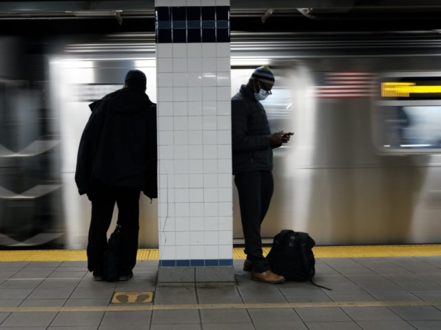 NEW YORK, NEW YORK - NOVEMBER 18: People wait for a subway train at a Brooklyn station on November 18, 2020 in New York City. In a bid to save $1.2 billion, the Metropolitan Transportation Authority (MTA) announced its budget for the upcoming year which includes cutting as much as …