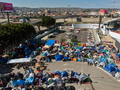Aerial view of a migrants camp where asylum seekers wait for US authorities to allow them to start their migration process outside El Chaparral crossing port in Tijuana, Baja California state, Mexico on March 17, 2021. - President Biden's pledge of a more humane approach has sparked a new rush …