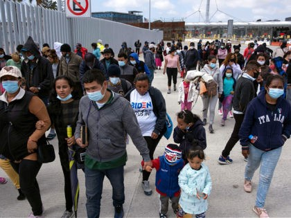 Migrants and asylum seekers awl after a demonstration at the San Ysidro crossing port asking US authorities to allow them to start their migration process in Tijuana, Baja California state, Mexico on March 23, 2021. - Migrants out of MPP program are stranded along the US-Mexico border without knowing when …