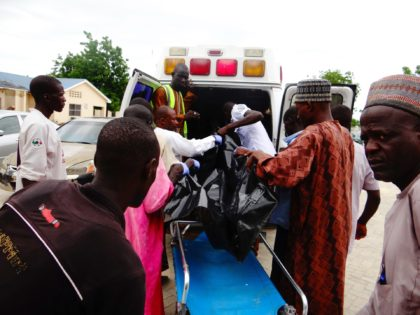 A victim is brought to the State Specialist Hospital in Maiduguri, northeastern Nigeria on July 29, 2017 the day after two suicide bombers struck a camp for displaced people in Dikwa, 90 kilometres (56 miles) east of Maiduguri, killing five. Civilian militia member Babakura Kolo said the attackers disguised themselves …