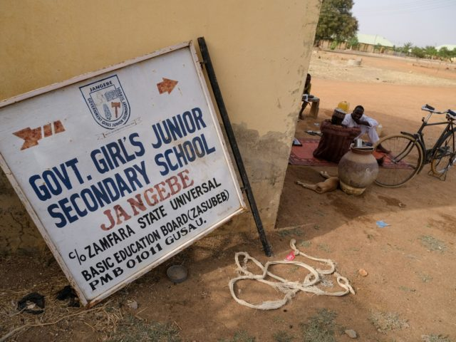A signboard of the Government Girls Secondary School is pictured after over 300 schoolgirls were kidnapped by bandits in Jangebe, a village in Zamfara State, northwest of Nigeria on February 27, 2021. - More than 300 schoolgirls were snatched from dormitories by gunmen in the middle of the night in …