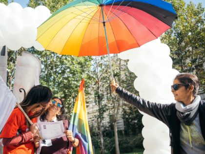 A woman kisses her girlfriend during a mock up marriage ceremony on October 6, 2019, in Bucharest, Romania, during an event organised one year after the country had held a referendum to define marriage as explicitly between a man and woman. - Representatives of the LGBT community in Romania ask …