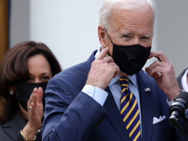 WASHINGTON, DC - MARCH 12: U.S. President Joe Biden (R) takes off his mask as Vice President Kamala Harris (L) looks on during an event on the American Rescue Plan in the Rose Garden of the White House on March 12, 2021 in Washington, DC. President Biden signed the $1.9 …