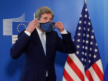 US Special Presidential Envoy for Climate John Kerry poses for a photograph after a meeting in Brussels, on March 9, 2021. (Photo by Olivier HOSLET / POOL / AFP) (Photo by OLIVIER HOSLET/POOL/AFP via Getty Images)