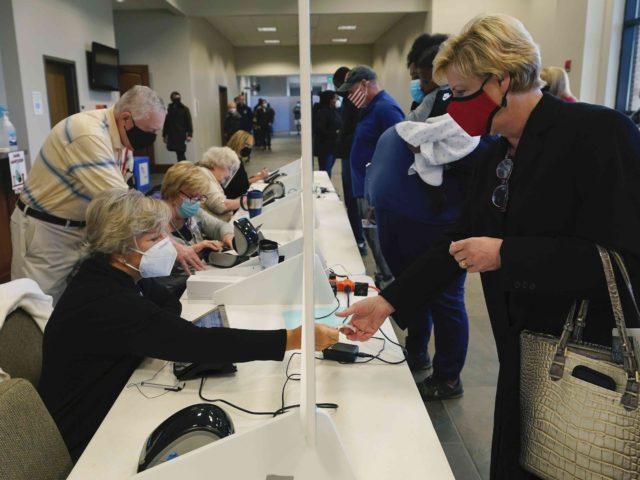 voter ID (Rogelio V. Solis / Associated Press)
