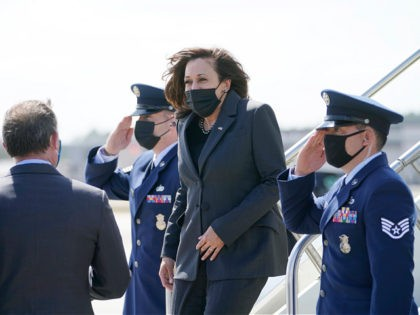 Vice President Kamala Harris is greeted by Jacksonville Mayor Lenny Curry, left, as she steps off Air Force Two, Monday, March 22, 2021 in Jacksonville, Fla. (AP Photo/Jacquelyn Martin)