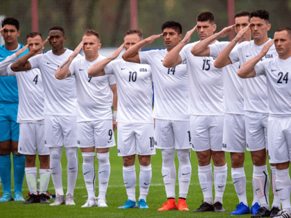 Armed Forces men's soccer team members salute at the start of a preliminary round match with Qatar for the Council of International Sports for Military 2019 Military World Games in Wuhan, China, Oct. 16, 2019.