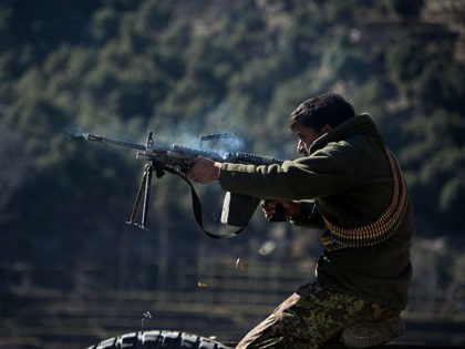 An Afghan National Army (ANA) soldier fires a rifle during an ongoing anti-Taliban operation in Dangam district near the Pakistan-Afghanistan border in eastern Kunar province on January 17, 2015. Afghan security forces have launched a joint anti-militant operation in parts of Dangam, killing 199 armed insurgents and wounding 112 others, …