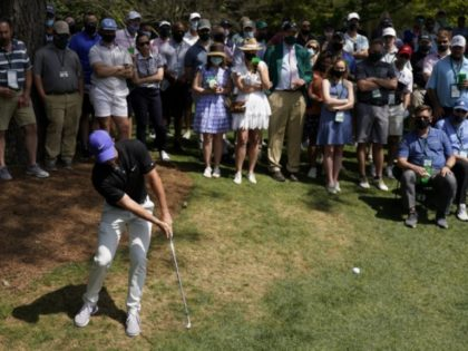 WATCH: Fore, Dad! McIlroy Sends Errant Masters Shot off his Father