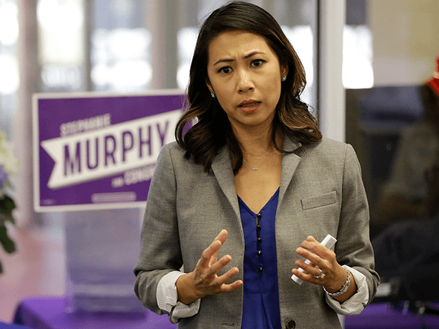 In this photo taken Oct. 18, 2016, Florida Democratic Congressional candidate Stephanie Murphy meets with voters at a senior center in Altamonte Springs, Fla. Rep. John Mica, R-Fla., is seeking a 13th term in Congress from central Florida, but it's not an easy path. The veteran Republican tells supporters turnout …